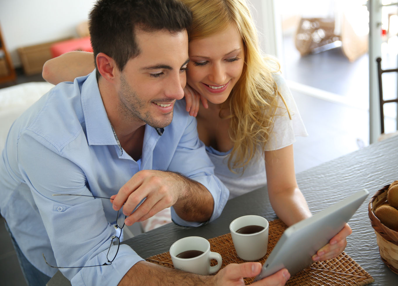 happy man and woman shopping online on a tablet